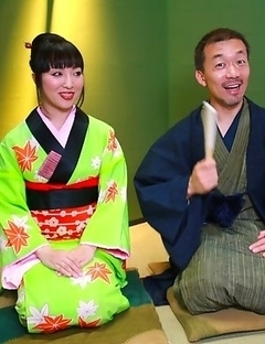 Asian babe sucking a large dick
